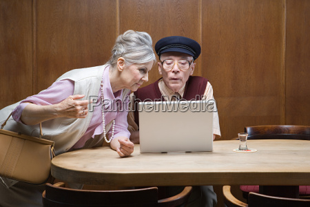 senior couple in public house with