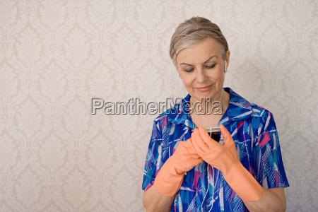senior woman looking at mp3 player