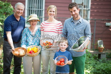 three generation family with homegrown vegetables