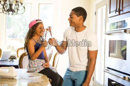 father and daughter in kitchen making