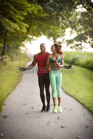 young, couple, training, on, path, skipping - 18847986