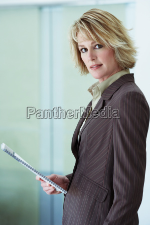 businesswoman holding booklet