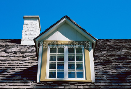 window and chimney on roof of