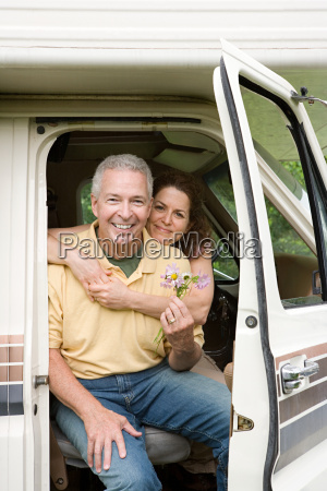 mature couple hugging in caravan