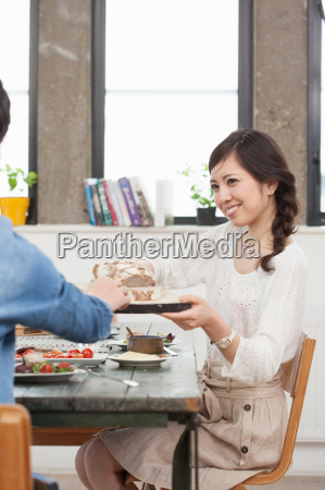 young couple enjoying lunch at table