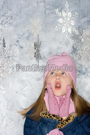 girl looking at snowflakes