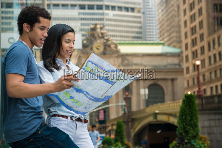 couple reading road map