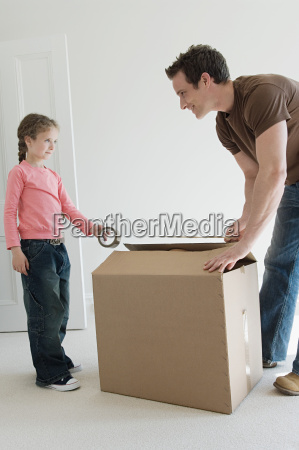 father and daughter taping up box