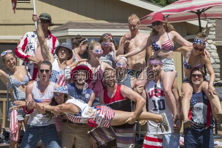 portrait of adult friends celebrating independence
