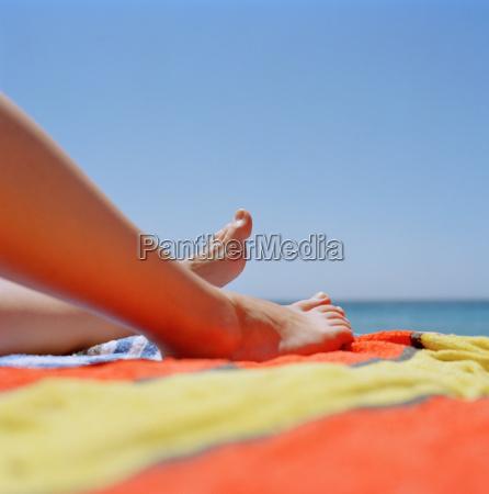 legs of woman sunbathing