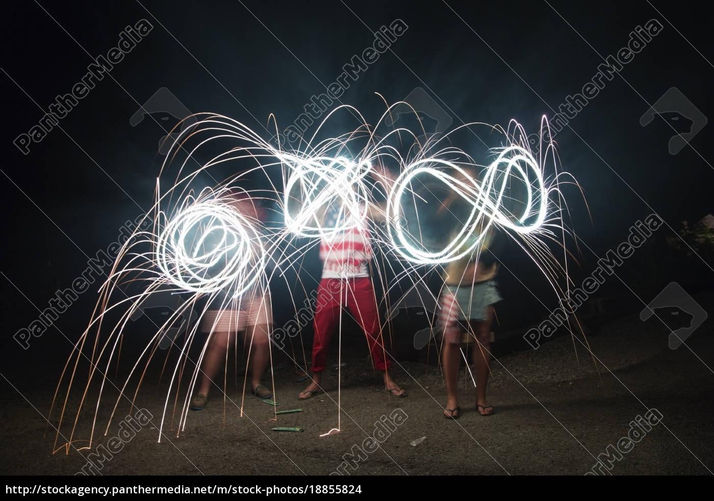 four, adult, friends, making, sparkler, patterns - 18855824
