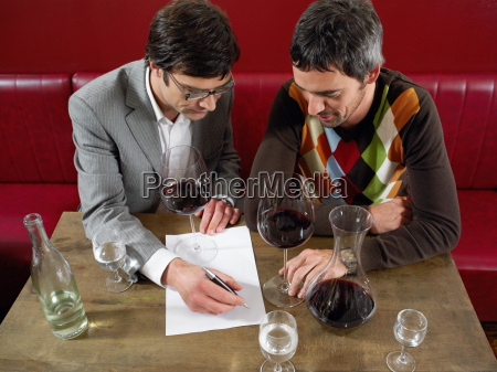 two men at wine tasting