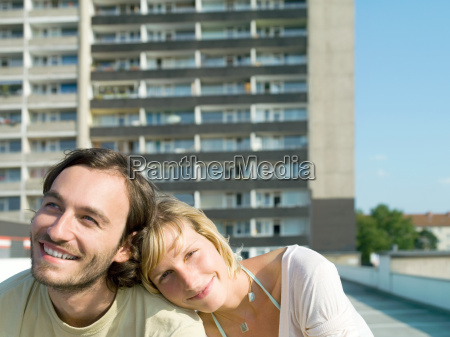 young couple by apartment building