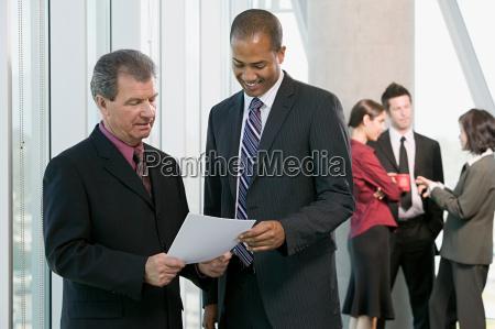businessmen looking at paperwork