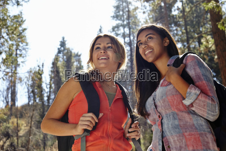 two young adult females hiking in