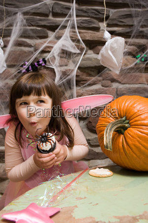 girl with a spider cake
