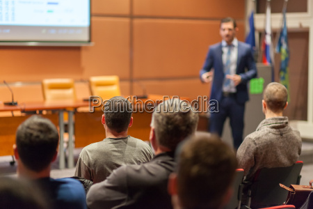 business speaker giving a talk in