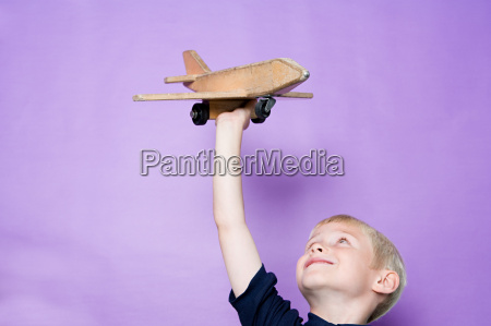 boy playing with aeroplane