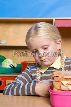 girl looking at lunch box