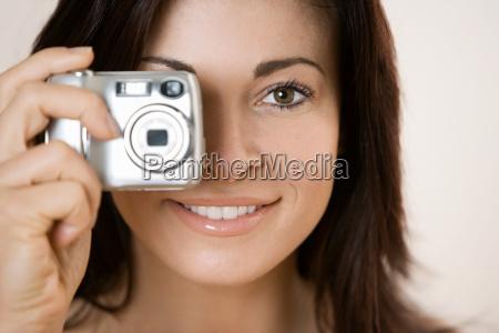woman using digital camera