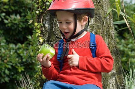 boy in a bike helmet with