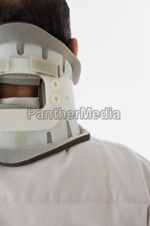 man wearing a neck brace