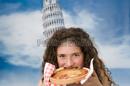 girl eating pizza with tower of