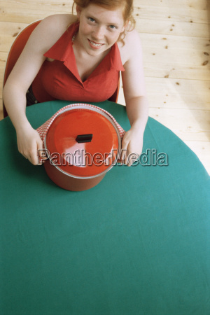 girl holding red pot