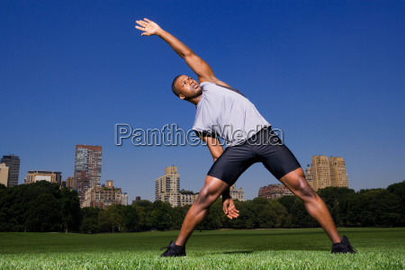 man stretching in the park