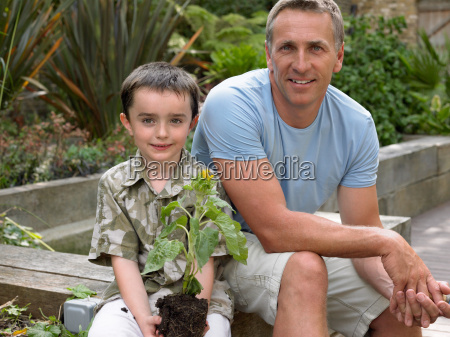 father and son in garden