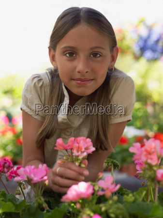 girl holding a plant