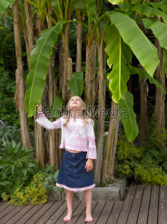 girl holding the leaf of a