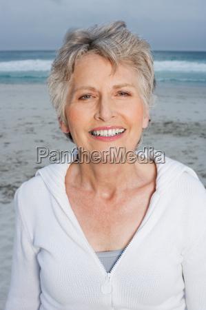senior adult woman on beach