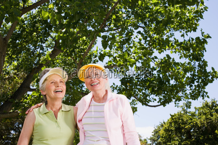 two senior adult women in park