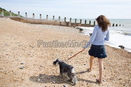 woman walking a pet dog