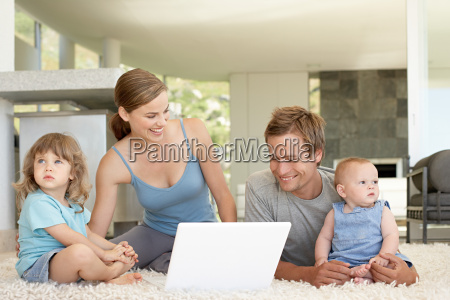 family using laptop computer