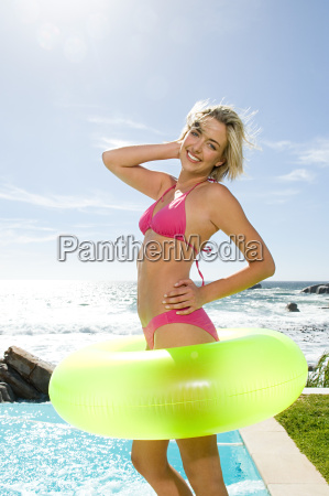 young woman in inflatable ring