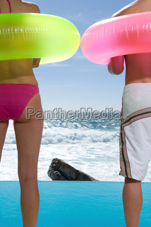 couple standing by infinity pool