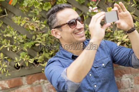 mid adult man outdoors taking self