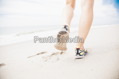 mid adult woman walking on beach