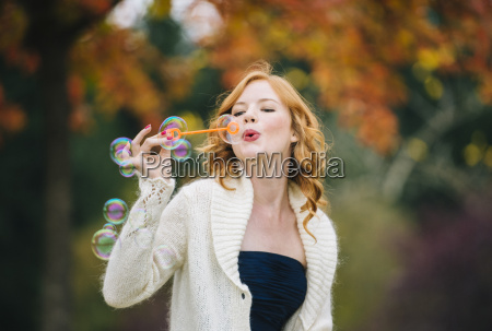 young beautiful woman with red wavy