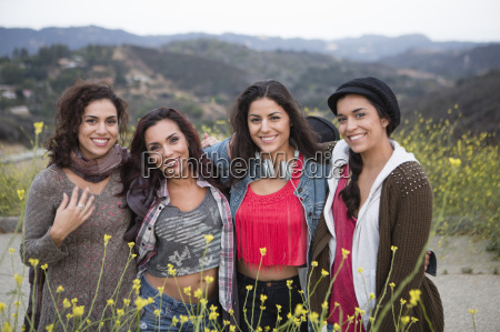 portrait of four adult sisters on