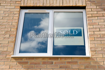 sold sign in window of new