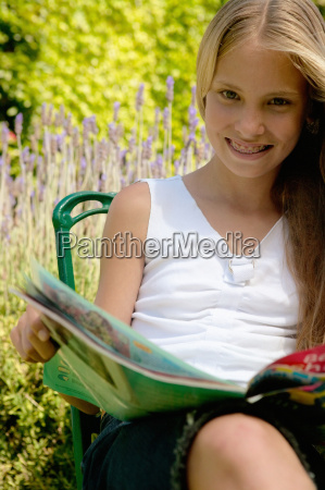 young girl with a magazine