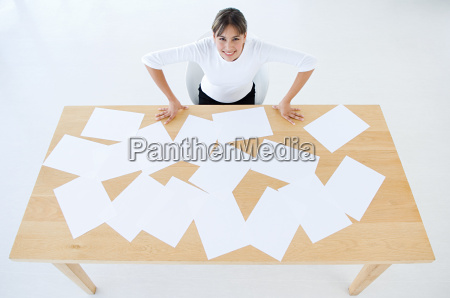 woman with desk of paper work