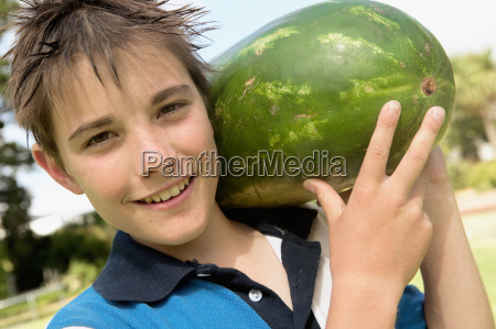 smiling boy with water melon