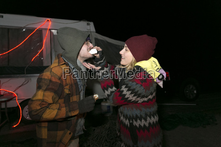 young couple at camp site at