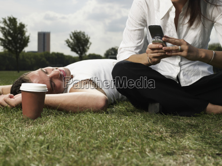 young couple resting in a park