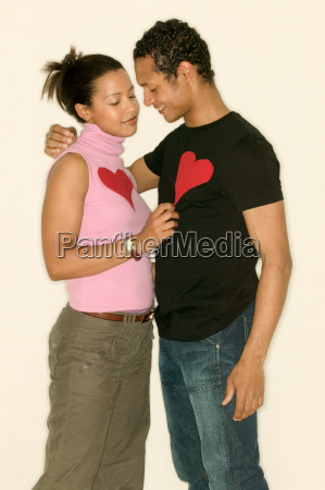 young couple wearing heart shapes