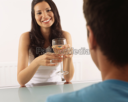 woman having glass of wine with